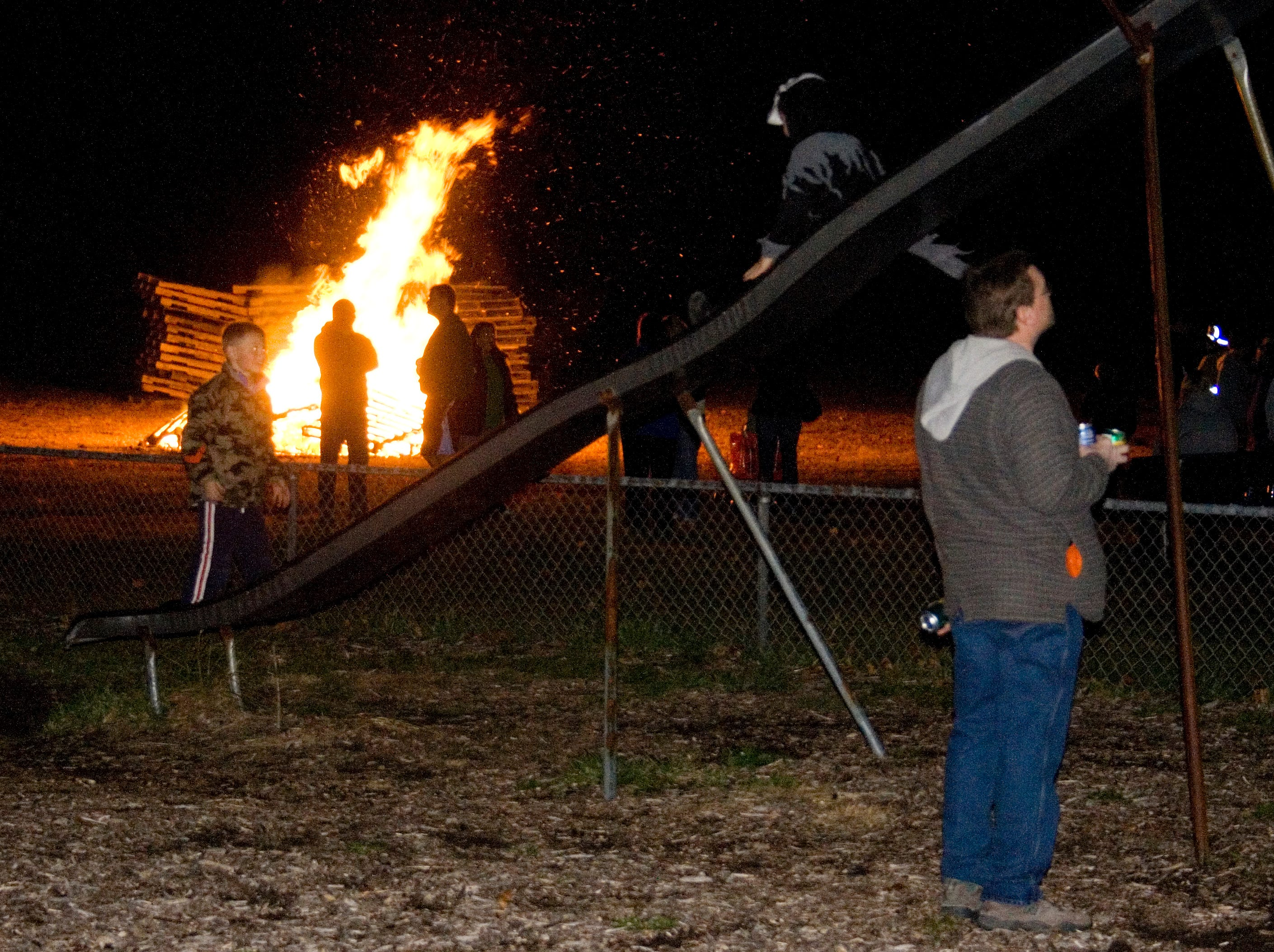 2008: Kids play on a slide at McCann's Park in Elmira Heights on Sunday evening as firefighters build a bonfire in the background. The bonfire was part of a haunted house and several other Halloween activities at the park sponsored by the Elmira Heights Police Benevolent Association.