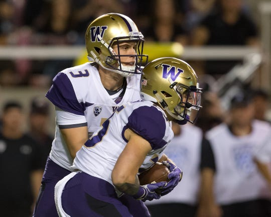 Sean McGrew takes a handoff from Jake Browning during a September game against Utah. McGrew has seen more snaps after UW starter Myles Gaskin suffered an injury two weeks ago against Oregon.