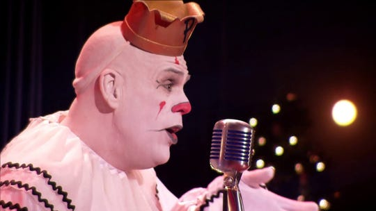 Puddles the Clown doesn't speak, but sings powerful versions of pop and rock songs in a rich baritone voice.