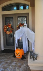 Mike and Amy Spurny go all out, taking most of the day to decorate their Fairway Lakes home in Viera for Halloween. The home is a favorite for local trick-or -treaters. Approaching the front door for candy can be intimidating.