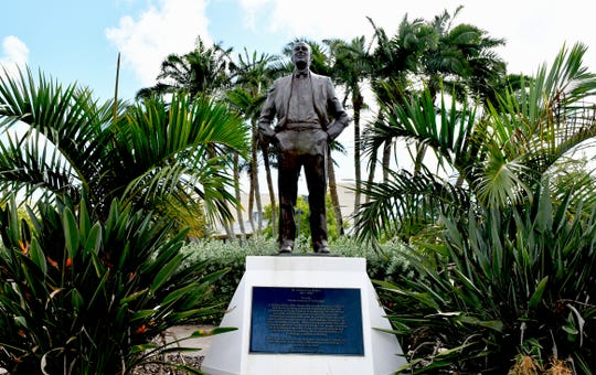 The campus statue of Jerome Keuper (1921-2002), founder of the Florida Institute of Technology, overlooks the Academic Quad plaza.