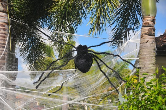 Mike and Amy Spurny go all out, taking most of the day to decorate their Fairway Lakes home in Viera for Halloween. The home is a favorite for local trick-or -treaters.