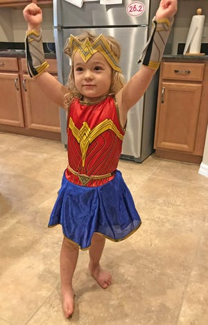 Isabella gets set to go to Boo at the Zoo at Brevard Zoo wearing her Wonder Woman costume.