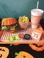 Employees at CC Braces in Corpus Christi decorated a pumpkin as a Whataburger.