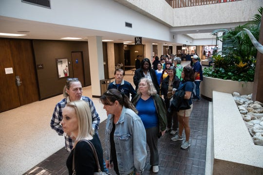 People stand inline to at the Nueces County Courthouse to voter as they take part in Indivisible's March The Vote on the first day of early voting in Texas on Monday, Oct. 22, 2018.v