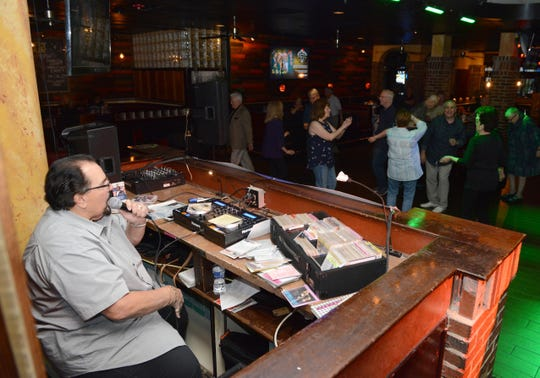"""DJ King Arthur excites the crowd during """"Golden Oldies'' night at Vera's Bar and Grill in Cherry Hill."""