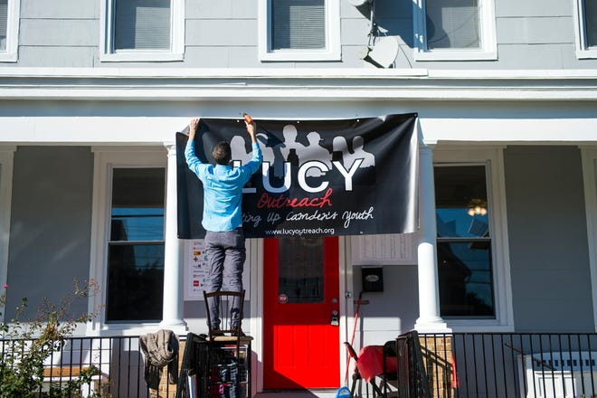 A sign for LUCY (Lifting Up Camden's Youth) is hung outside the program's new home.