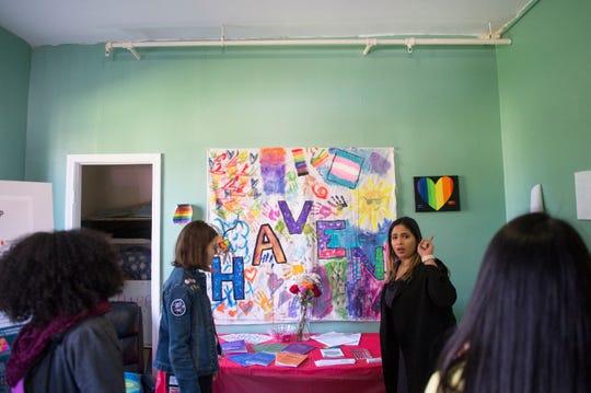 Program coordinator Yoresmi 'Beba' Lopez speaks with LUCY participants.