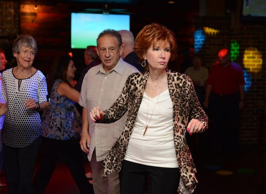 The electric slide lures dancers to the floor at Vera Bar and Grill in Cherry Hill, which features Golden Oldies and Coastline reunion dancing on Monday nights.
