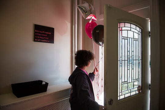A participant carries balloons as LUCY's new home is prepped for use.