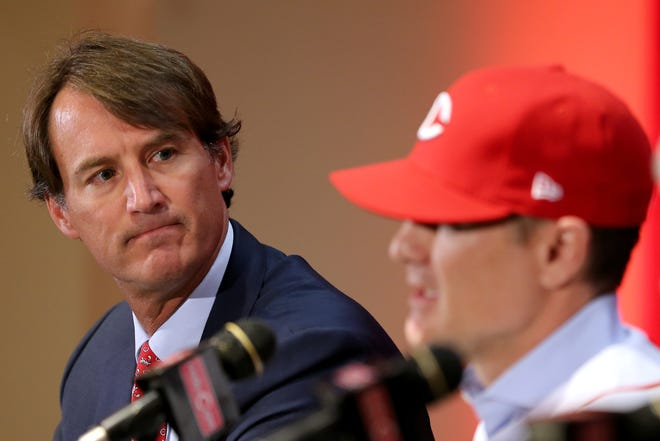Cincinnati Reds President of Baseball Operations Dick Williams, left, listens as David Bell, right, answers questions after he who was introduced as the next field manager, Monday, Oct. 22, 2018, at Great American Ball Park in Cincinnati.