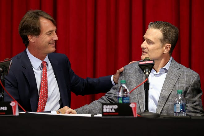 Cincinnati Reds President of Baseball Operations Dick Williams, left, shakes hands with David Bell, right, who was introduced as the next field manager, Monday, Oct. 22, 2018, at Great American Ball Park in Cincinnati.