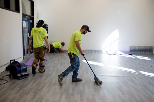 Construction workers put in a dance floor at The Madcap Education Center on Monday, Oct. 22, 2018 in Cincinnati.