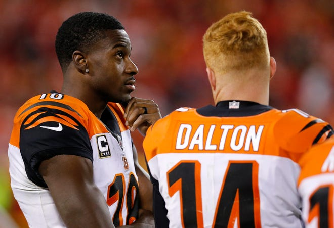 Cincinnati Bengals wide receiver A.J. Green (18) and quarterback Andy Dalton (14) talk on the sideline after the leave the game late in the fourth quarter of the NFL Week 7 game between the Kansas City Chiefs and the Cincinnati Bengals at Arrowhead Stadium in Kansas City, Mo., on Tuesday, Oct. 16, 2018. The Bengals lost 45-10, falling to 4-3 on the season.