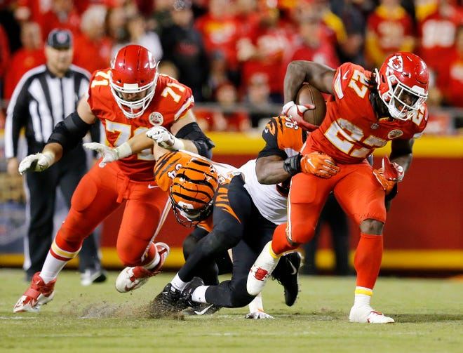 Kansas City Chiefs running back Kareem Hunt (27) makes a carry up the middle in the fourth quarter of the NFL Week 7 game between the Kansas City Chiefs and the Cincinnati Bengals at Arrowhead Stadium in Kansas City, Mo., on Tuesday, Oct. 16, 2018. The Bengals lost 45-10, falling to 4-3 on the season.