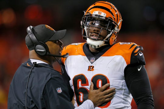 Cincinnati Bengals head coach Marvin Lewis talks with offensive tackle Bobby Hart (68) between plays in the fourth quarter of the NFL Week 7 game between the Kansas City Chiefs and the Cincinnati Bengals at Arrowhead Stadium in Kansas City, Mo., on Tuesday, Oct. 16, 2018. The Bengals lost 45-10, falling to 4-3 on the season.