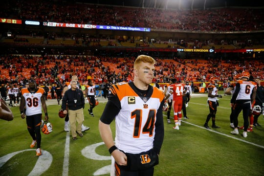 Cincinnati Bengals quarterback Andy Dalton (14) walks on to the field to shake hands after the fourth quarter of the NFL Week 7 game between the Kansas City Chiefs and the Cincinnati Bengals at Arrowhead Stadium in Kansas City, Mo., on Tuesday, Oct. 16, 2018. The Bengals lost 45-10, falling to 4-3 on the season.