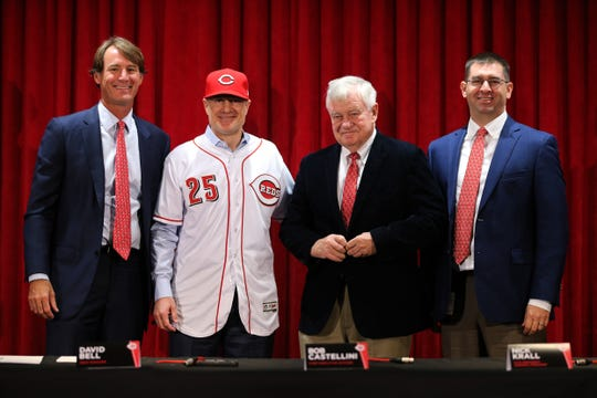 From left: Cincinnati Reds President of Baseball Operations Dick Williams, new field manager David Bell, Reds CEO Bob Castellini, General Manager Nick Krall, smile for a photo as Bell puts on a No. 25 uniform during his introduction as the next field manager, Monday, Oct. 22, 2018, at Great American Ball Park in Cincinnati.