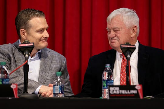 Cincinnati Reds Chief Executive Officer Bob Castellini, right, shakes hands with David Bell, left, who was named the team's next field manager ,Monday, Oct. 22, 2018, at Great American Ball Park in Cincinnati.