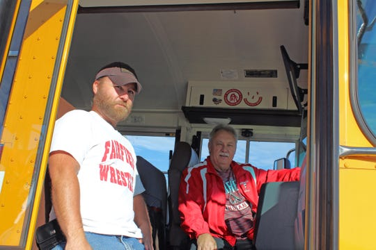 New Fairfield bus driver David Shoemaker, left, rode bus trainer Marvin Hundley's school bus when he was in middle school.