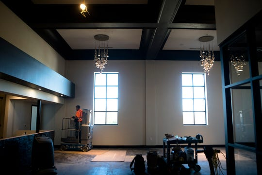 Construction workers put in hanging lights at The Madcap Education Center on Monday, Oct. 22, 2018 in Cincinnati.