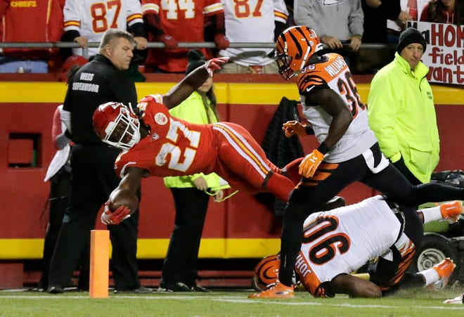 Kansas City Chiefs running back Kareem Hunt (27) reaches across the goal line for a touchdown in the second quarter of the NFL Week 7 game between the Kansas City Chiefs and the Cincinnati Bengals at Arrowhead Stadium in Kansas City, Mo., on Tuesday, Oct. 16, 2018.