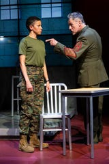 """Flor De Liz Perez and Michael Cullen in a scene from the George Street Playhouse production of """"The Trial of Donna Caine."""""""