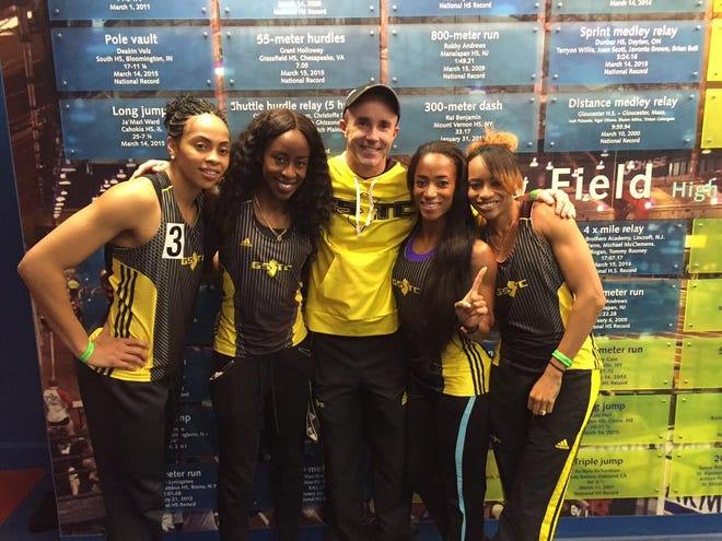 Charlie Schneekloth (center) pictured with the Garden State Track Club's 4 X 200 women's relay team after it broke the Millrose Games record in 2017.