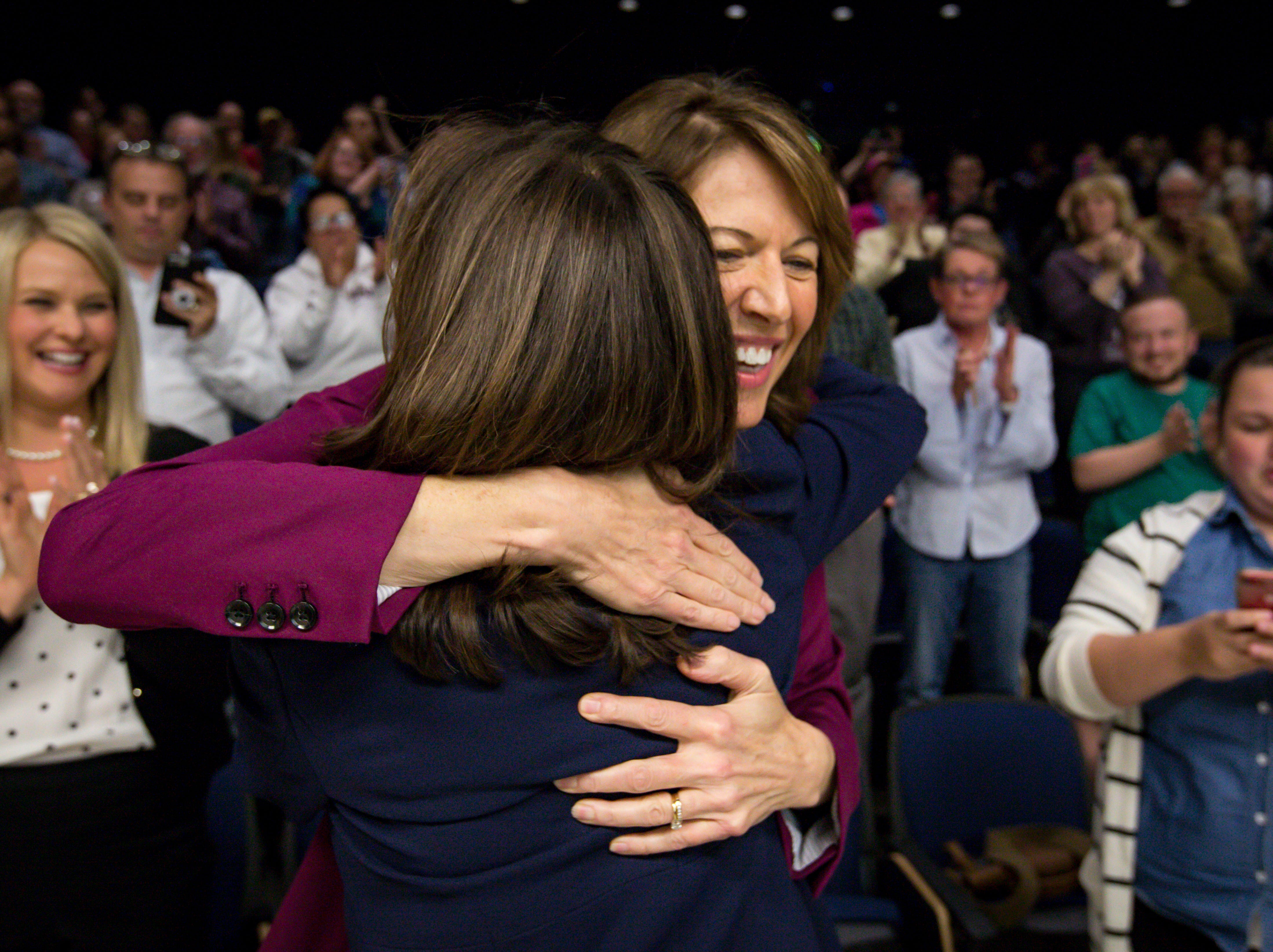 Democratic Senator Kamala Harris of California hugs Congressional candidate Cindy Axne after a DMACC Early Vote rally  Monday, Oct. 22, 2018, in Ankeny, Iowa.