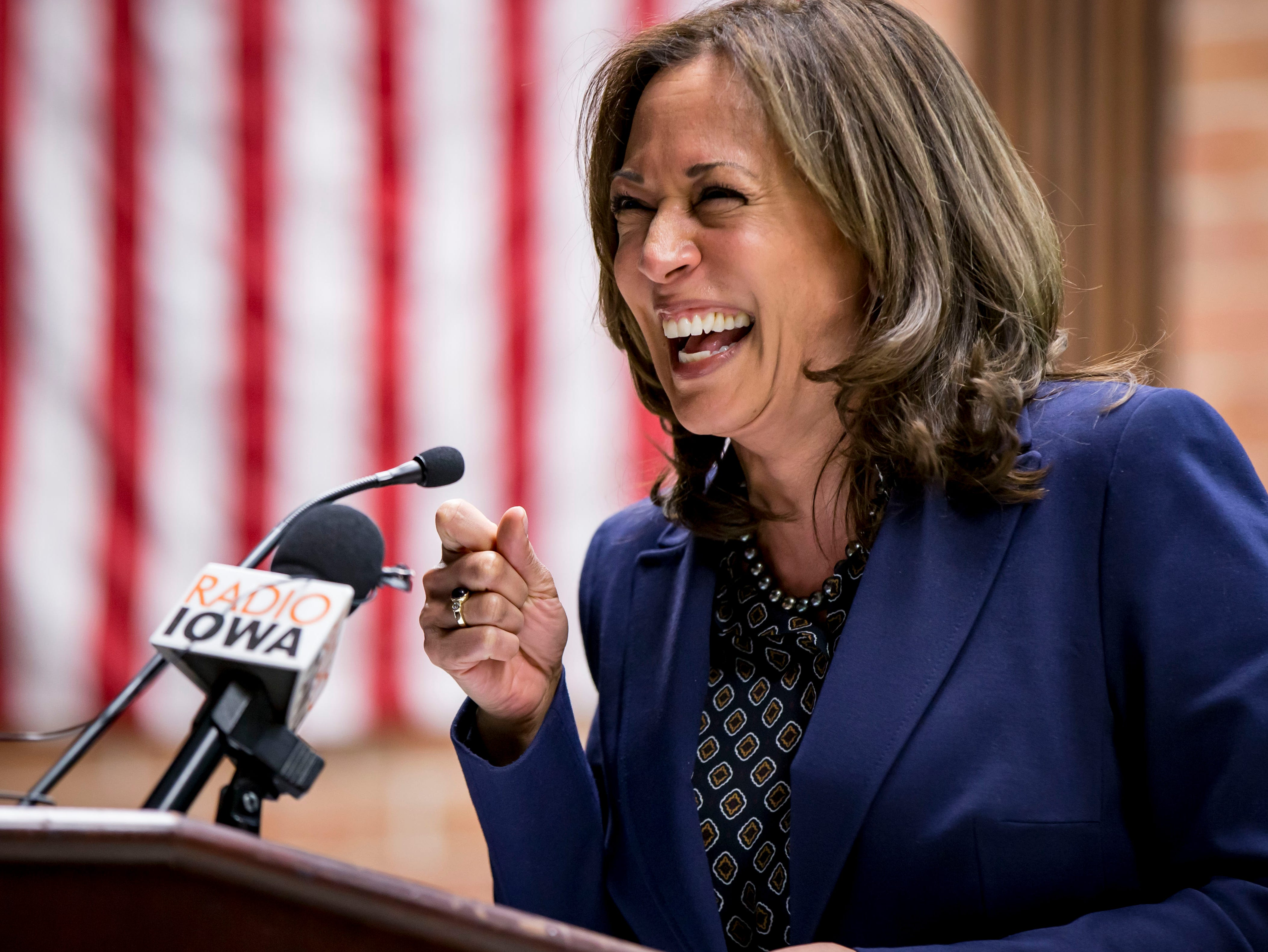 Democratic Senator Kamala Harris of California laughs during a DMACC Early Vote rally  Monday, Oct. 22, 2018, in Ankeny, Iowa. She appeared with Congressional candidate Cindy Axne, State Senate candidate Amber Gustafson and Iowa House candidate Heather Maston.