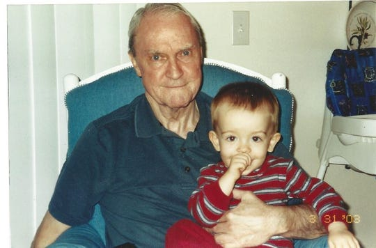 "James ""Jim"" William O'Brien sits with his 18-month-old grandson Matthew, a few months before he died from pulmonary fibrosis."