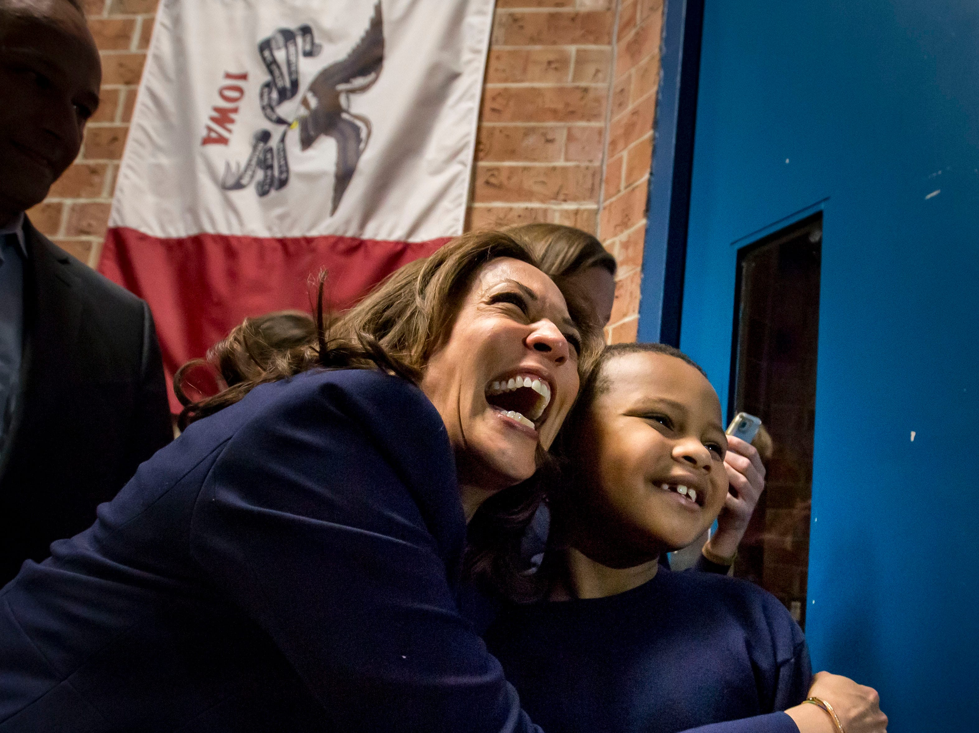 Democratic Senator Kamala Harris of California hugs Manaath Kai, 8, of Des Moines after a DMACC Early Vote rally  Monday, Oct. 22, 2018, in Ankeny, Iowa. She appeared with Congressional candidate Cindy Axne, State Senate candidate Amber Gustafson and Iowa House candidate Heather Maston.