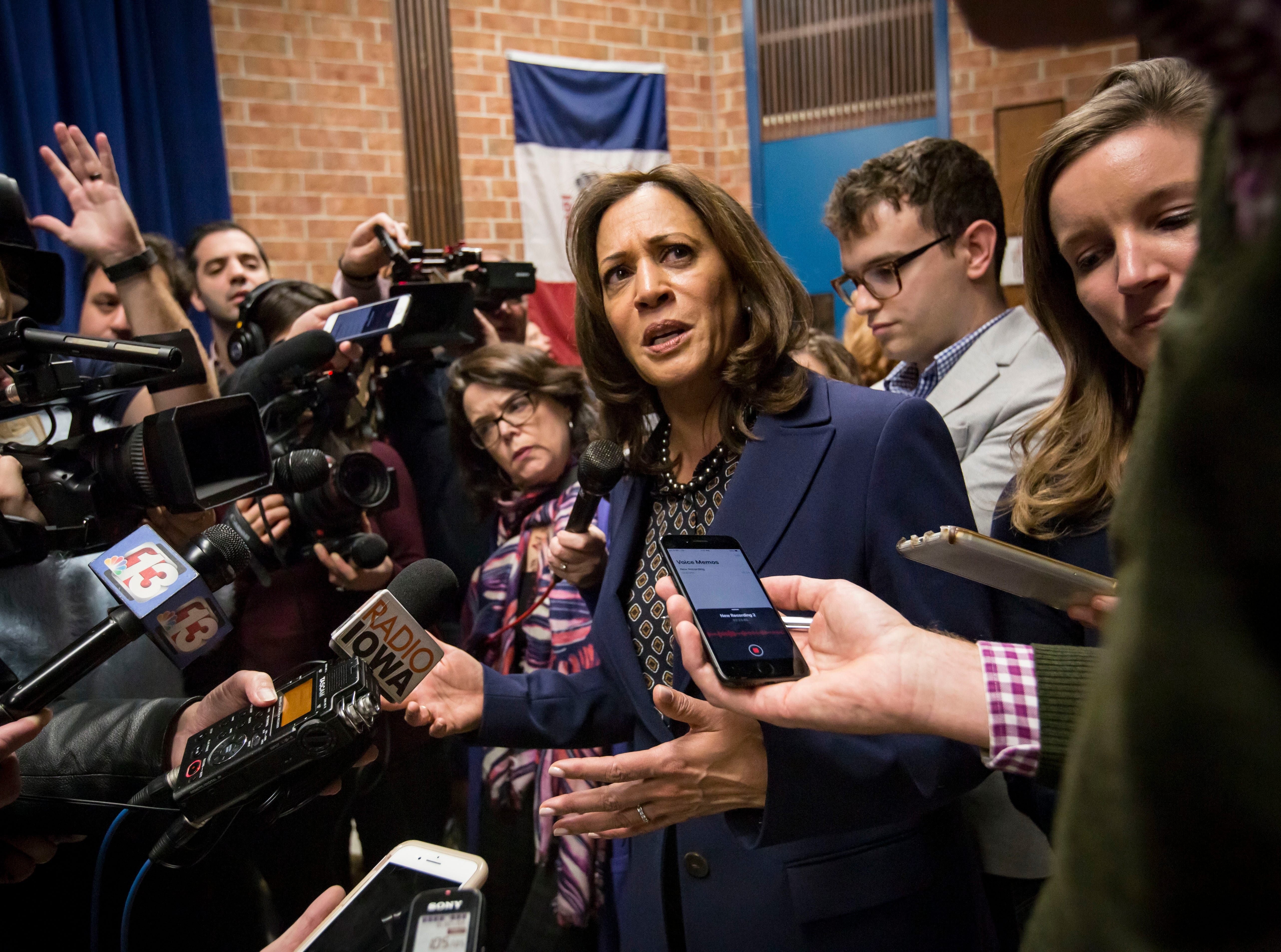Democratic Senator Kamala Harris of California talks to the media after a DMACC Early Vote rally  Monday, Oct. 22, 2018, in Ankeny, Iowa. She appeared with Congressional candidate Cindy Axne, State Senate candidate Amber Gustafson and Iowa House candidate Heather Maston.
