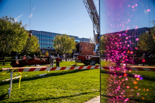 """Workers install """"Iron Tree Trunk,"""" by Chinese artist Ai Weiwei at the John and Mary Pappajohn Sculpture Park Monday, Oct. 22, 2018."""