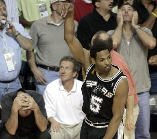 Robert Horry celebrates his shot to beat the Pistons in Game 5.