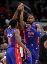 Glenn Robinson III, right, celebrates with Langston Galloway after scoring against the Bulls during the second half Saturday in Chicago.