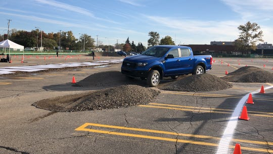 The 2019 Ford Ranger on an off-road course at its assembly plant
