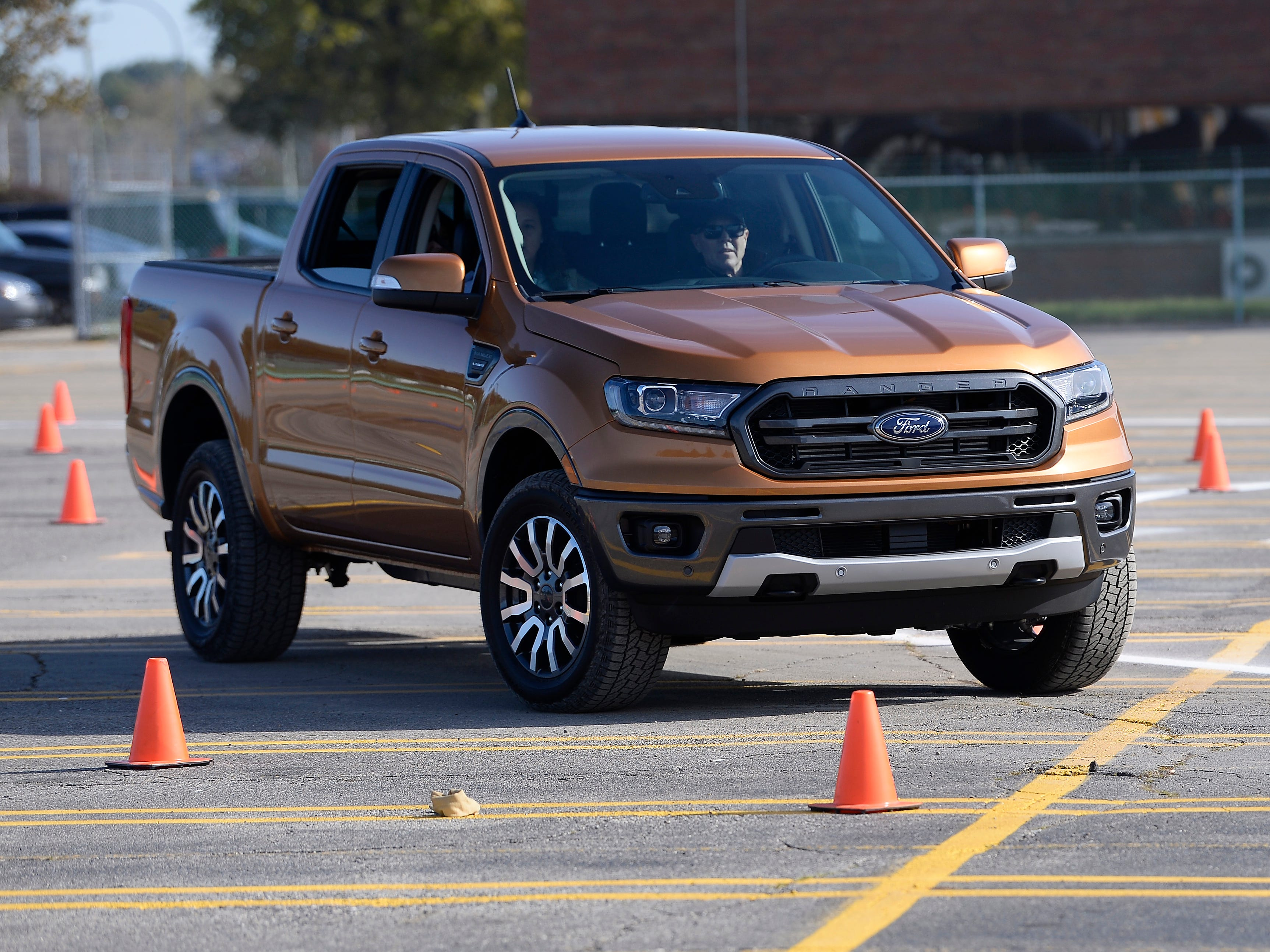 Ford employees at the Michigan Assembly Plant in Wayne, Michigan, had the chance to drive hand-built 2019 Ford Ranger pickups Monday on a makeshift off-road course set up in the plant's parking lot. Official production begins October 29 at the plant, which will build its first trucks since 2010.