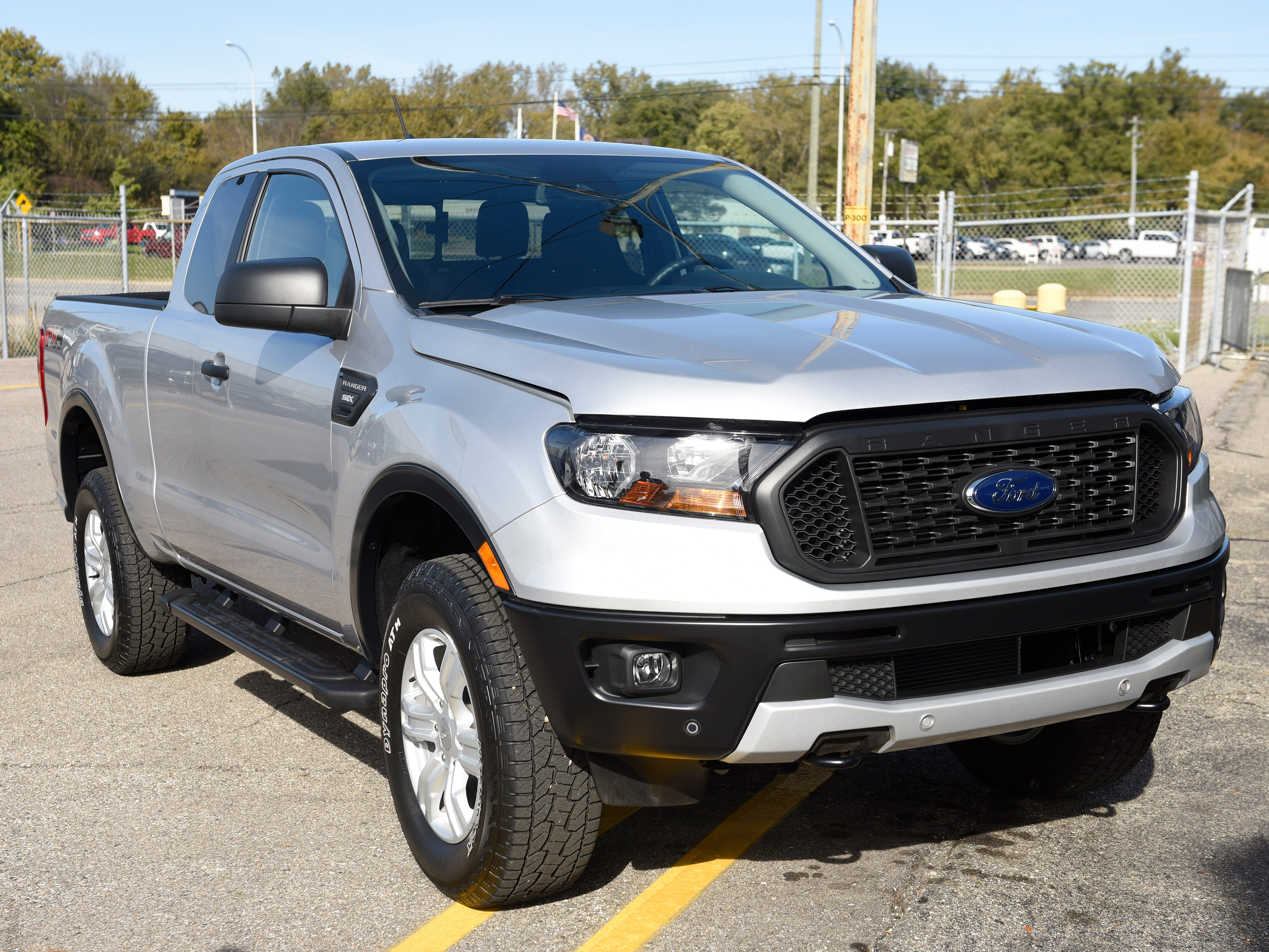 Ford held a celebratory event outside the factory Monday, a week ahead of the official launch, so that factory workers could get rides in hand-built models and check out the midsize pickup's features and after-market add-ons the automaker is planning.