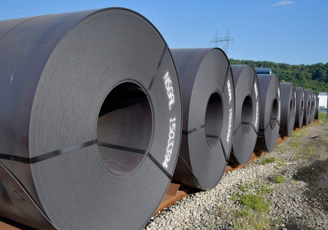 Rolls of steel weighing in at 20 tons or more await shipment at the NUCOR Steel Gallatin plant, Wednesday, July 25, 2018, in Ghent, Ky. The plant has been operating 24 hours a day seven days a week to meet the demand.