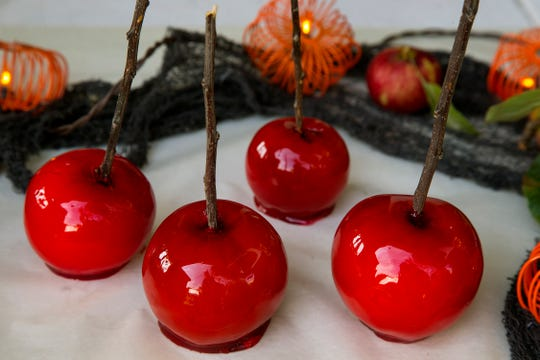 Candied apples: Apples coated with cooked sugar, flavoring and a little food coloring.   (Kirk McKoy/Los Angels Times/TNS)