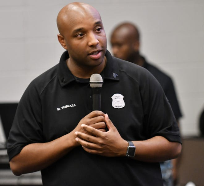 Detroit police Sgt. Marcus Thirlkill welcomes the young men during a Cuts and Coding educational event for young black males at the Ford Research and Engagement Center on Maddelein Street in Detroit on Aug. 9, 2018. This is one week of an ongoing project with Detroit police Sgt. Marcus Thirlkill and some of his co-workers who meet with the young men each week doing various mentorship programs.