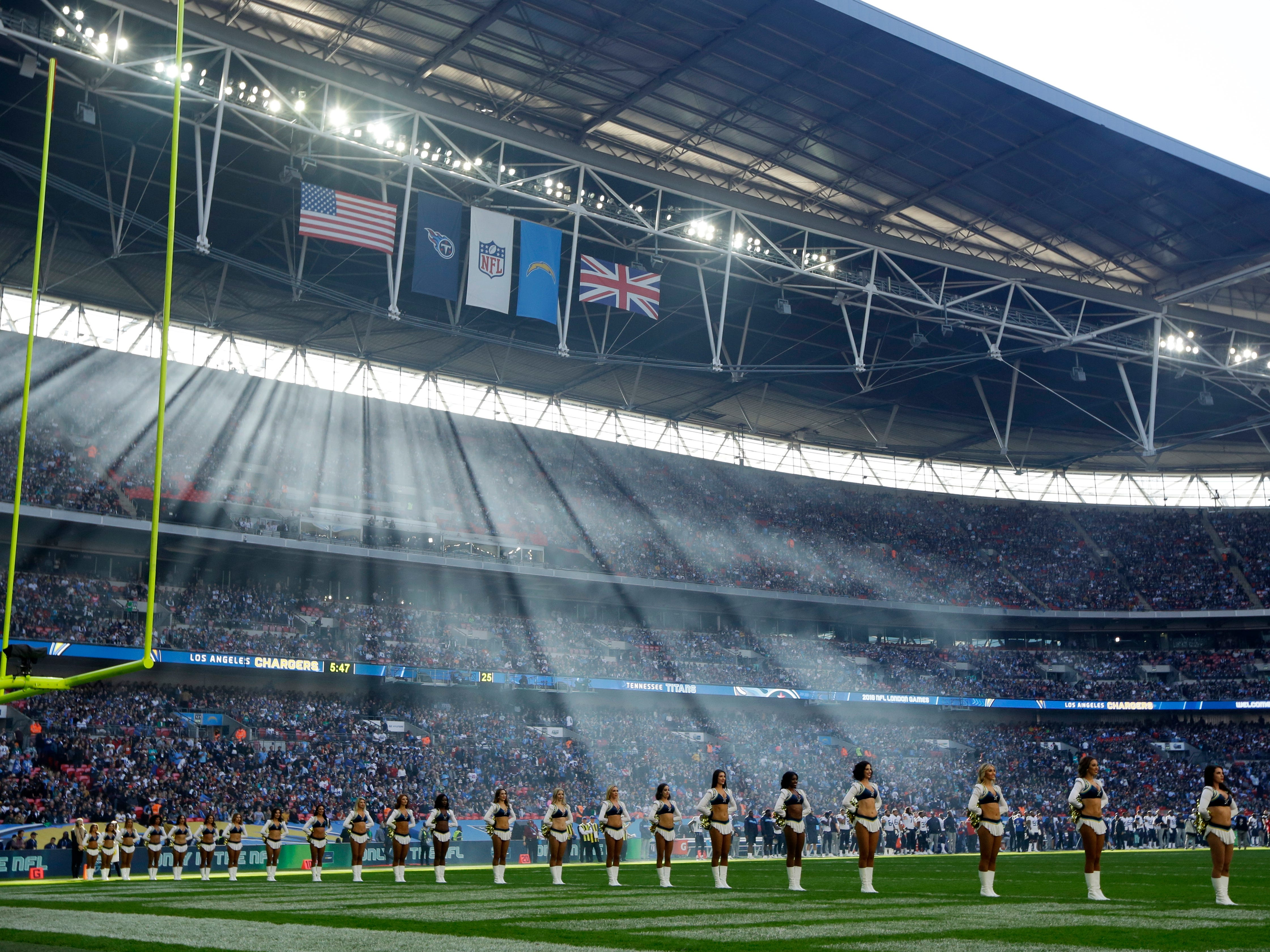 Cheerleaders line up before an NFL football game between Tennessee Titans and Los Angeles Chargers at Wembley stadium in London, Sunday, Oct. 21, 2018.