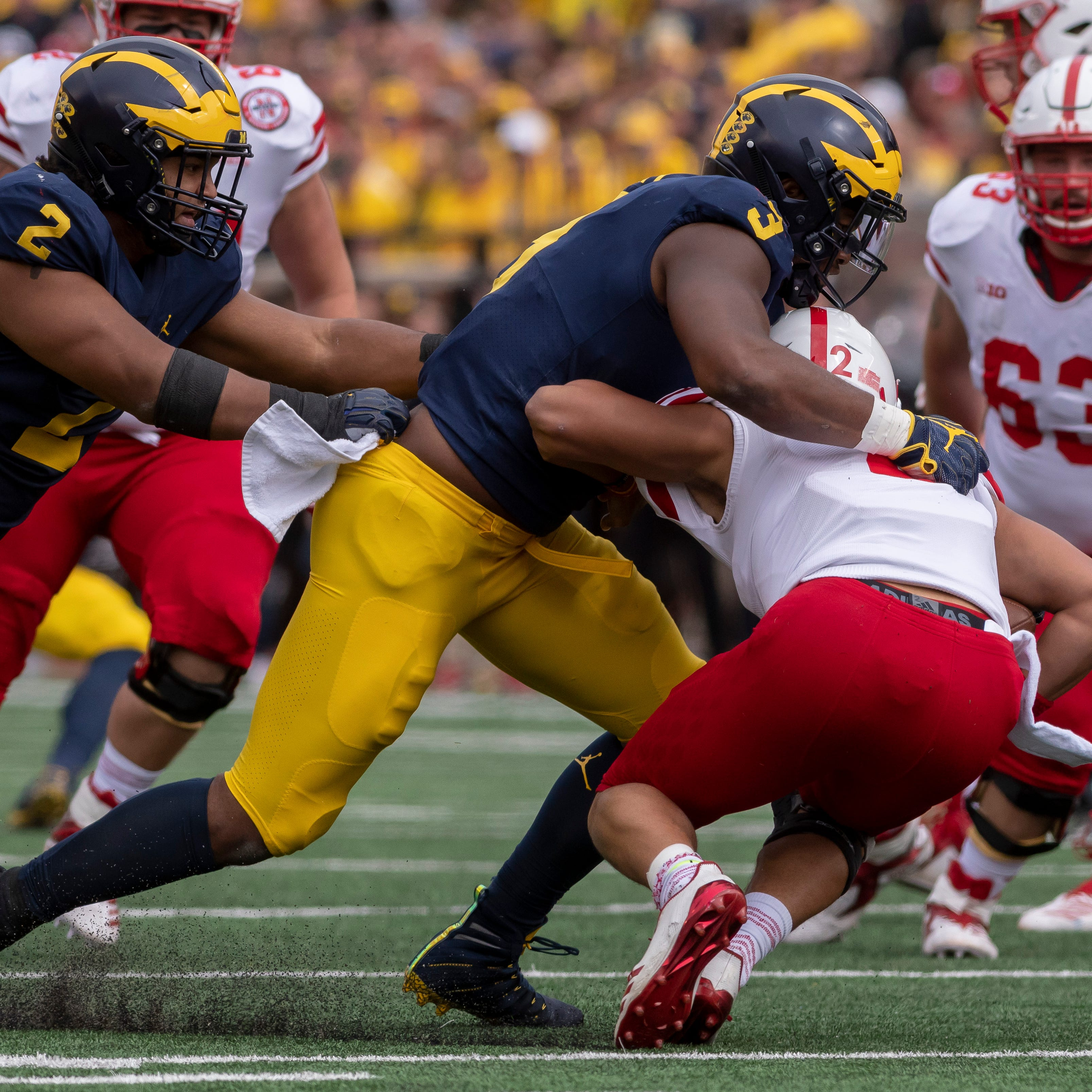 Injured Rashan Gary's status remains unclear for Michigan