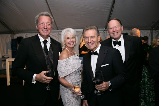 Syd and Elizabeth Ross, from left, Craig Hall and Jim Nicholson