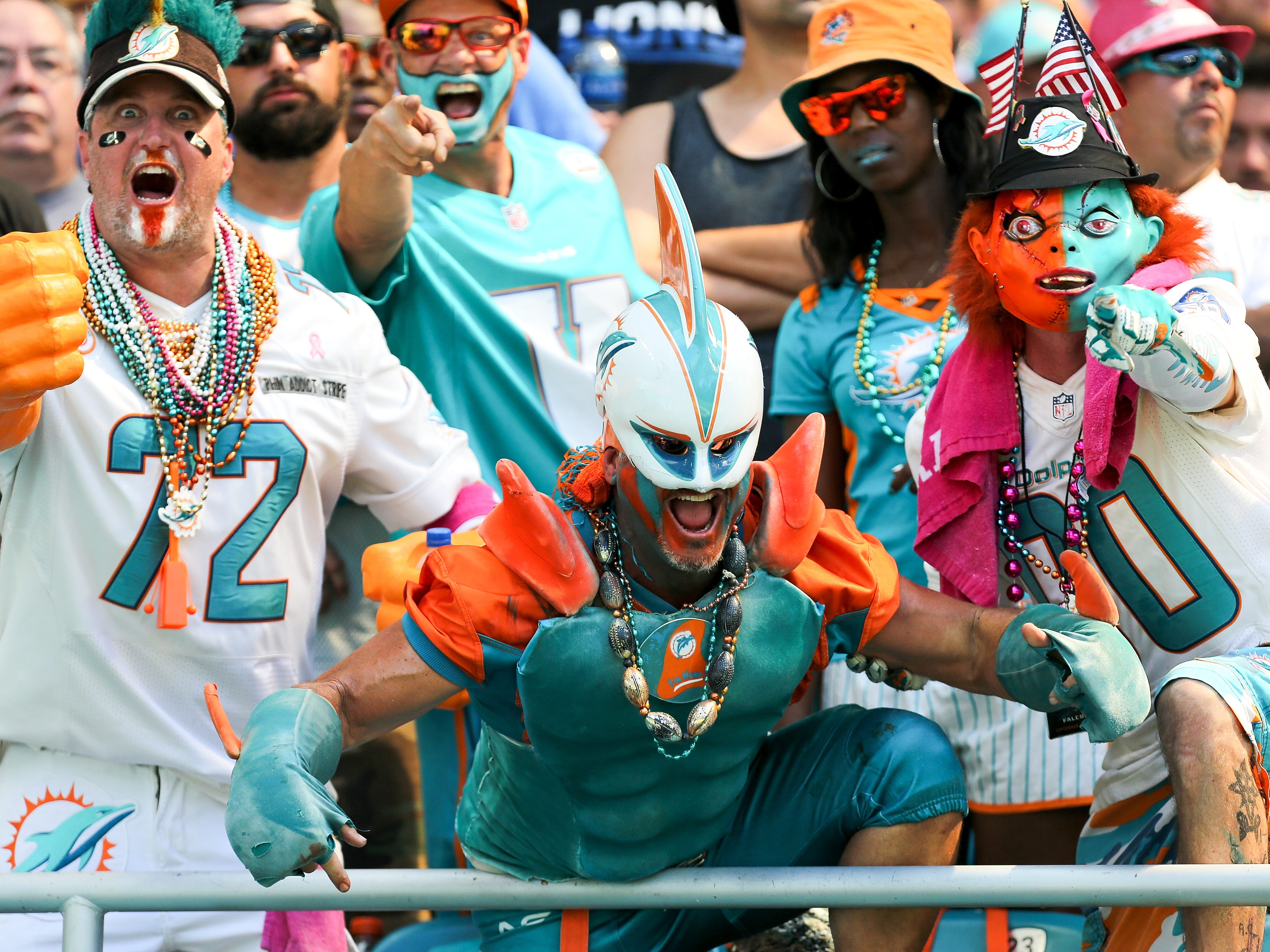 Miami Dolphins fans react during the first half of a game against the Detroit Lions at Hard Rock Stadium in Miami, Florida, on October 21, 2018.