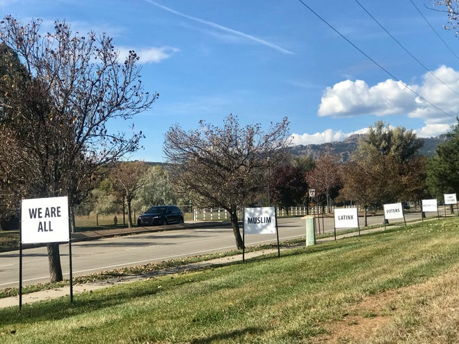 Signs line Drake Road in Fort Collins outside of the Foothills Unitarian Church. Community support helped the church replace them after vandals destroyed and took down the signs in mid October.