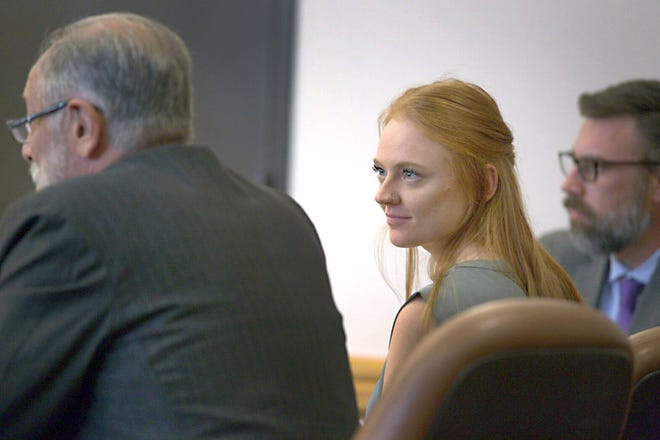 Michaella Surat, middle, listens as her attorney, David Lane, left, speaks to the judge during her sentencing hearing at the Larimer County Justice Center Monday afternoon. Surat was found guilty of misdemeanor charges of obstructing a peace officer and resisting arrest back in August.