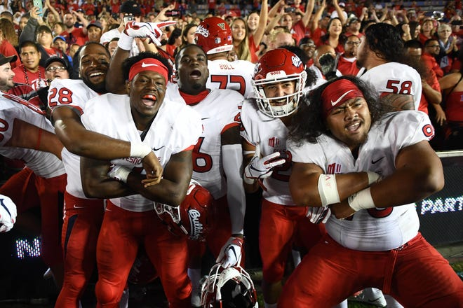 Fresno State football players celebrate their 38-14 win Sept. 15 over UCLA at the Rose Bowl in Pasadena, Calif. The Bulldogs, winners of five straight games, moved up to No. 1 this week in our weekly Mountain West football power ratings.