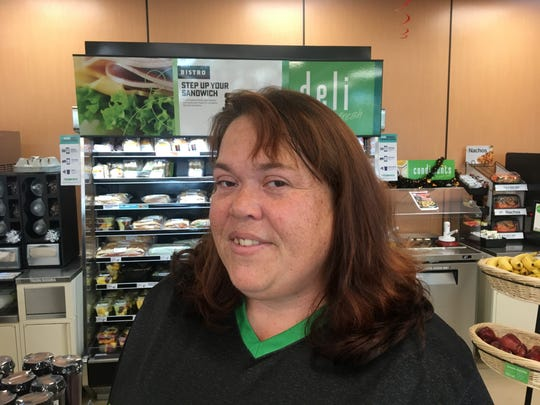 Tiffany Cullen, a 7-Eleven manager in Cape Coral, experiences brisk sales of Mega Millions tickets with a record $1.6 billion jackpot.